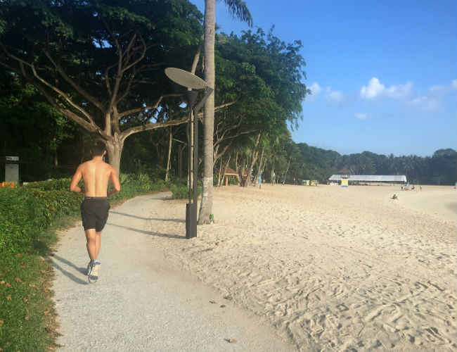 Running along Singapore's Sentosa Beach