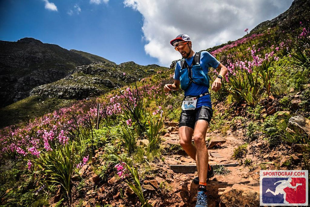 FloRuns running the last downhill of the Ultra-Trail Cape Town through a flower field.