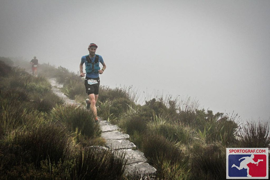 FloRuns running through the mist on top of Table Mountain right next to the ledge.