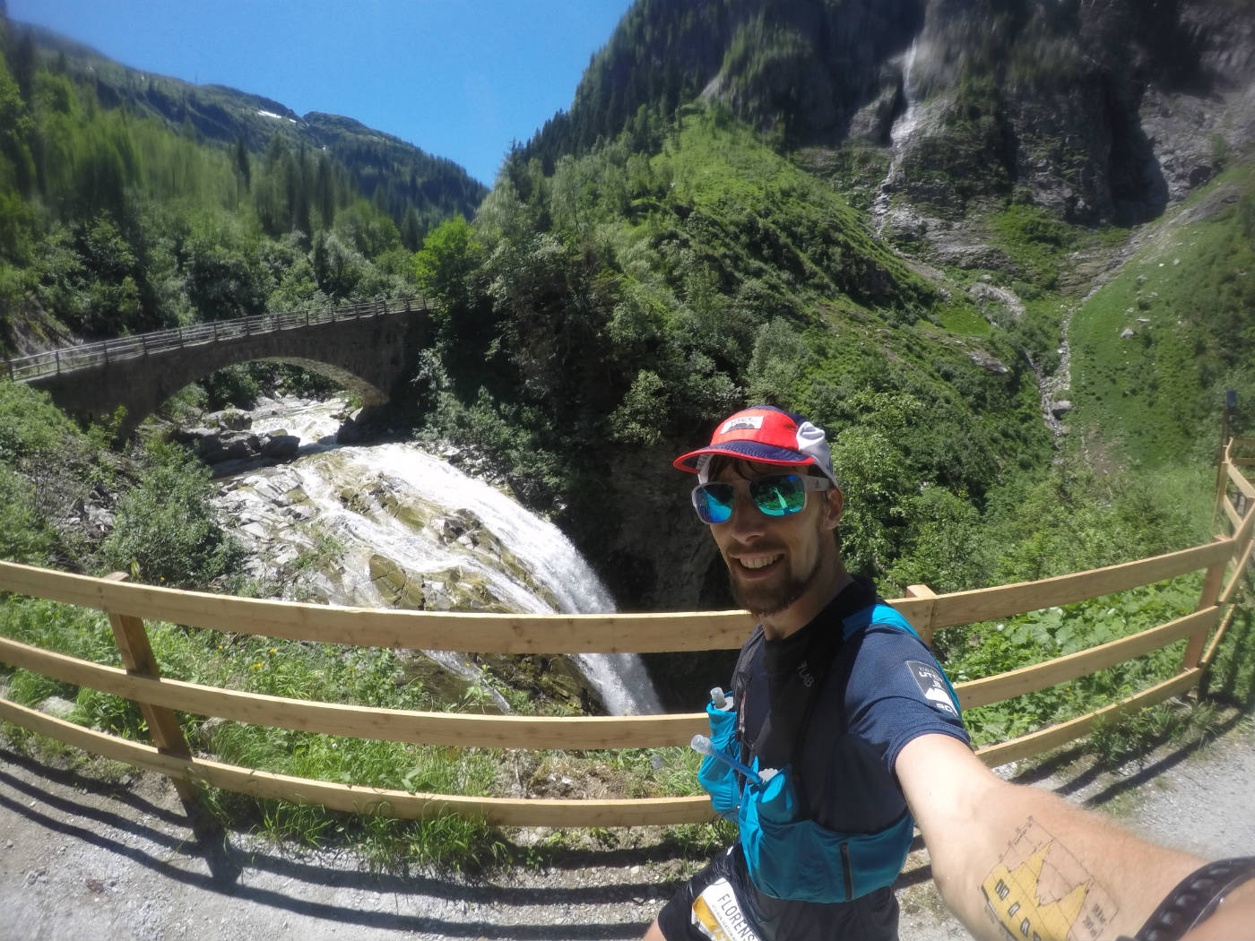 Taking a selfie during the Infinite Trails World Championships running past a waterfall and bridge