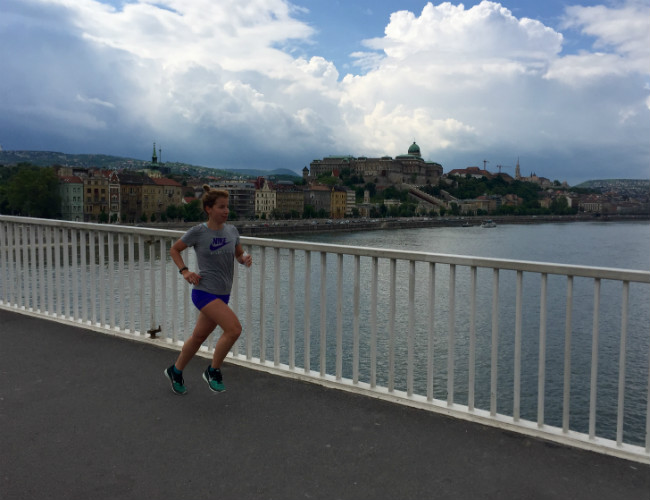 RUN TO DISCOVER Budapest crossing a bridge with the castle Buda in the background. RUN MY CITY guide by Csilla Fazekas.
